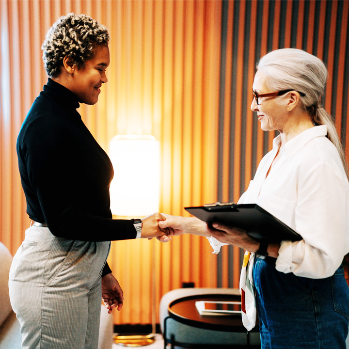 Businesswoman shaking hands with business woman